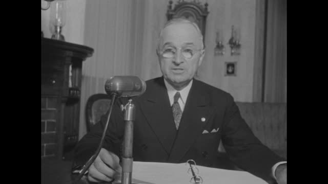 president harry s truman seated at desk in his living room for radio address / his house from across street - harry truman stock videos & royalty-free footage