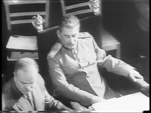 president harry s truman seated at large table / soviet premier joseph stalin at table / profile shot of stalin / overhead shot of world leaders at... - potsdam brandenburg stock videos & royalty-free footage