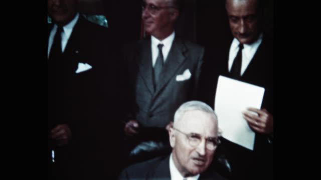 president harry s truman signing the north atlantic treaty behind him are sir derrick hoyes miller henrik de kauffman w d matthews louis johnson... - full suit stock videos & royalty-free footage