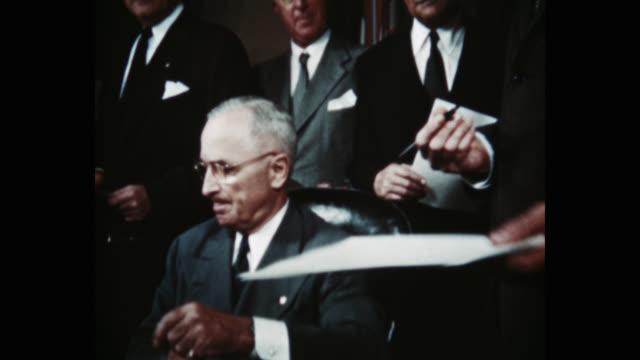 president harry s truman signing the north atlantic treaty behind him are sir derrick hoyes miller henrik de kauffman w d matthews louis johnson... - 10 seconds or greater stock videos & royalty-free footage