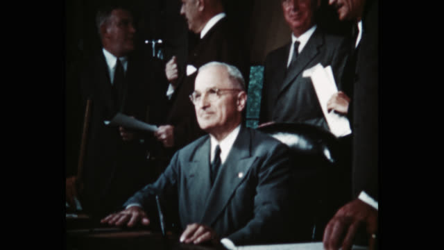 president harry s truman signing the north atlantic treaty, behind him are sir derrick hoyes miller, henrik de kauffman, w d matthews, louis johnson,... - less than 10 seconds stock videos & royalty-free footage