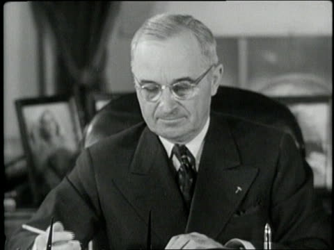 president harry s. truman signs the committee on civil rights report. - harry truman stock videos & royalty-free footage