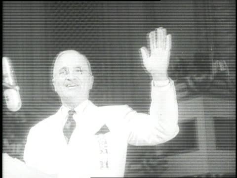 president harry s. truman smiles and waves from behind a podium at the democratic national convention. - harry truman stock videos & royalty-free footage