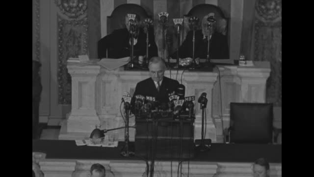president harry s truman speaking with president of senate sen kenneth mckellar and speaker of the house sam rayburn at rostrum behind him - sam rayburn video stock e b–roll