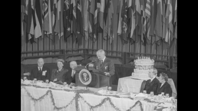 president harry s truman speaks to delegates of the columbia scholastic press association vips seated at table threetiered cake on cart next to... - 1949 stock videos & royalty-free footage