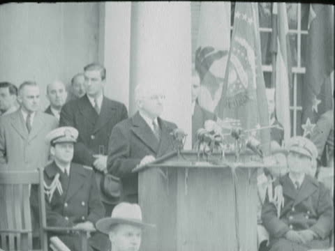 US President Harry S Truman standing at podium outside White House at a ceremony honoring Franklin D Roosevelt / Harry S Truman reading prepared...