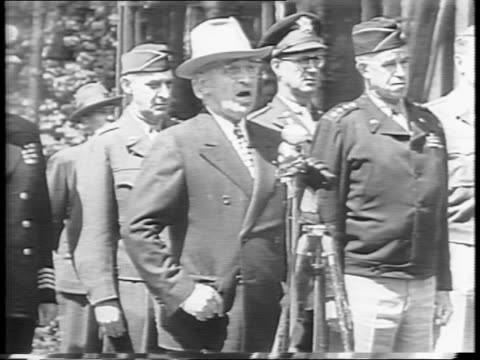 president harry s truman standing by a microphone and speaking to the troops of the the second armored division in berlin / truman says to not forget... - potsdam brandenburg stock videos & royalty-free footage
