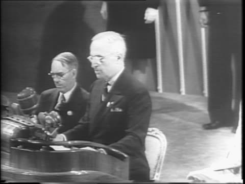 President Harry S Truman stands at podium and continues speaking to the United Nations delegation / montage of Truman speaking and delegates in crowd...