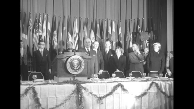 vs president harry s truman stands next to lectern at head table vips stand behind him camera flashes go off / foreground photojournalists take... - photojournalist stock videos & royalty-free footage