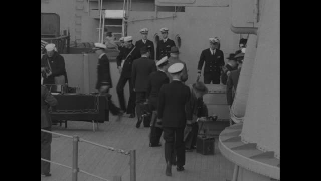 president harry truman and naval officers climbing ladder to board battleship uss missouri honor guard of sailors standing at attention on deck /... - missouri stock videos and b-roll footage