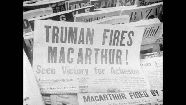 president harry truman discusses the korean war with reporters during a press conference / newspaper headlines stating: 'mac is out' and 'truman... - 空爆点の映像素材/bロール
