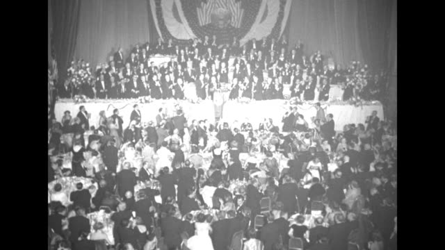 us president harry truman finishes speech at columbus day dinner at the waldorf astoria hotel and crowd gives standing ovation - waldorf astoria stock videos and b-roll footage