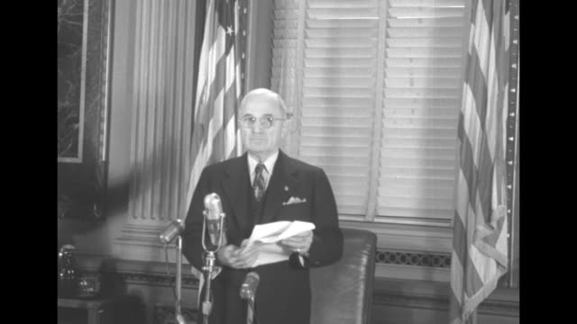 president harry truman holding a document standing in the indian treaty room of the executive office building before a press conference on the korean... - 大量破壊兵器点の映像素材/bロール