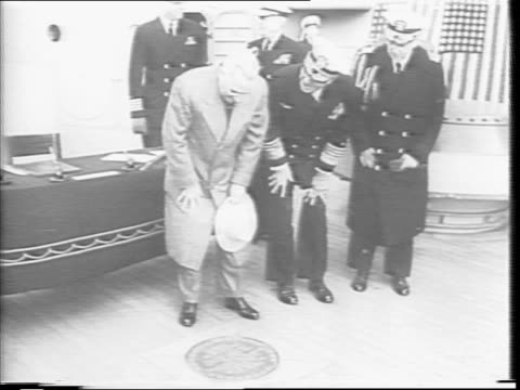president harry truman walks onto the deck of the uss missouri and shakes hands with a uniformed officer / mayor fiorello la guardia walks onto the... - japanese surrender stock videos and b-roll footage