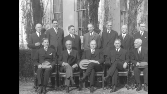 president herbert hoover sits with members of his cabinet on south lawn of white house left to right secretary of war patrick j hurley vice president... - herbert hoover us president stock videos & royalty-free footage