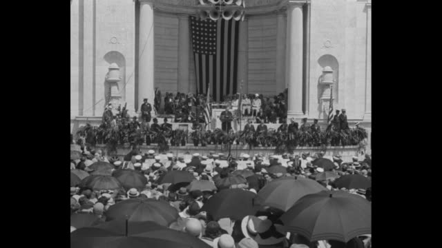 president herbert hoover speaks from memorial amphitheater in arlington national cemetery urging nation to live up to the kellogg antiwar pact flag... - herbert hoover us president stock videos & royalty-free footage