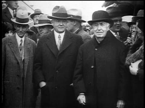 President Herbert Hoover Thomas Edison posing with crowd in background / Detroit / newsreel