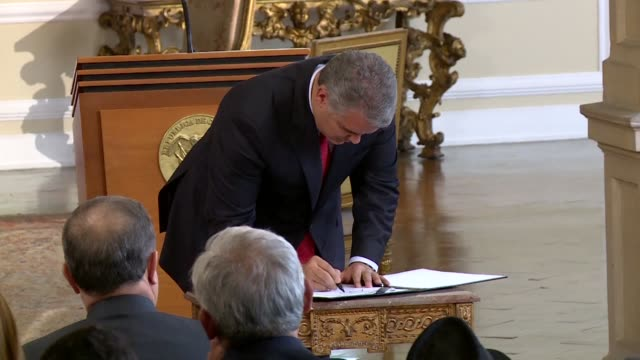 President Ivan Duque signs a decree to crackdown on drugs in the world's biggest cocaine producing country Colombia