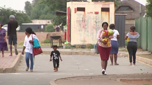 President Jacob Zuma faces calls to step down AERIAL Drone footage township of Sharpeville Women and children along on street Women along Neglected...