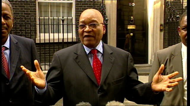 president, jacob zuma, speaks to press outside no.10 downing street; england: london: downing street: no.10: ext jacob zuma out of no.10 with... - out of context stock videos & royalty-free footage