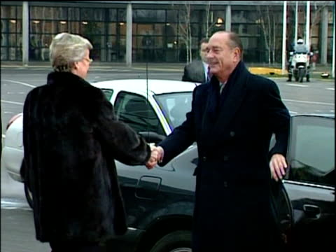 president jacques chirac arrives at eu summit and shakes hands with female official copenhagen 13 dec 02 - öresundregion stock-videos und b-roll-filmmaterial