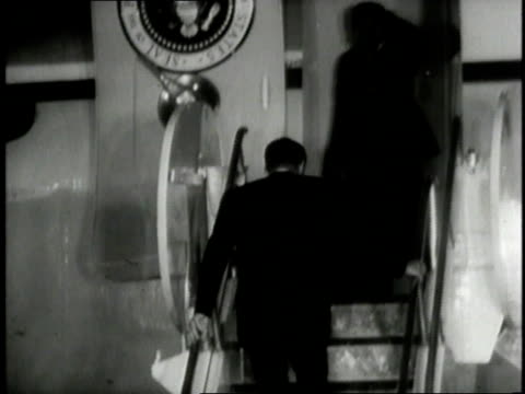 president jfk climbing stairs and waving as he boards air force one / washington dc united states - air force one stock videos & royalty-free footage