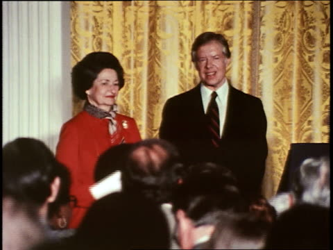 president jimmy carter, after speech at a white house press conference about the head start program, stands with lady bird johnson and receives... - jimmy carter us president stock videos & royalty-free footage