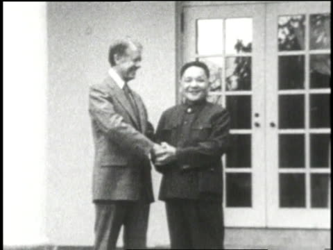 us president jimmy carter and chinese premier deng xiaoping shake hands in front of the white house - 1979 stock videos & royalty-free footage