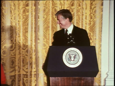 president jimmy carter speaks at a white house press conference about the head start program acknowledging the efforts of lady bird johnson and... - jimmy carter präsident stock-videos und b-roll-filmmaterial