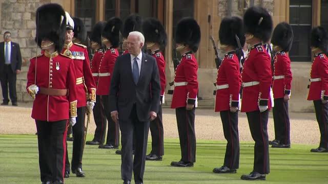 president joe biden inspects guard of honour, grenadier guards, at windsor castle during visit to meet queen elizabeth ii - us president stock videos & royalty-free footage