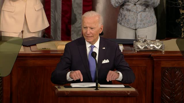 president joe biden tells a joint session of congress that the good guys and women on wall street did not build the country, but the middle class and... - 50 seconds or greater stock-videos und b-roll-filmmaterial