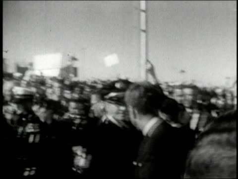 president john and jackie kennedy arrive in dallas texas to massive crowds shakes hands get in car - attentat auf john f. kennedy stock-videos und b-roll-filmmaterial