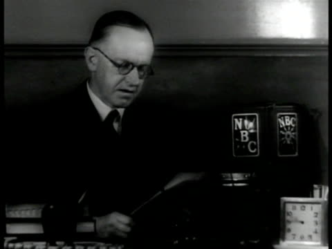 coolidge president john calvin coolidge seated at desk wearing reading glasses holding papers w/ nbc radio microphones on desktop - nbc stock videos & royalty-free footage