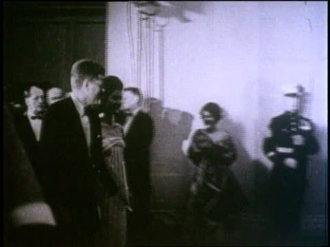 president john f. kennedy and first lady jacqueline kennedy attend a white house party. - john f. kennedy us president stock videos & royalty-free footage