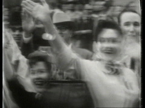 president john f. kennedy and first lady jacqueline kennedy greet supporters as they arrive in dallas and ride in a presidential motorcade through... - jackie kennedy stock videos & royalty-free footage