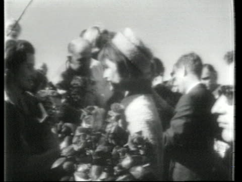 president john f. kennedy and first lady jacqueline kennedy greet spectators after arriving at love field in dallas on november 22, 1963. - jackie kennedy stock videos & royalty-free footage