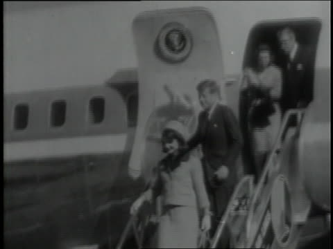 u.s. president john f. kennedy and his wife jacqueline smile as they disembark from air force one in dallas, texas, an hour before his assassination. - jacqueline kennedy stock videos and b-roll footage