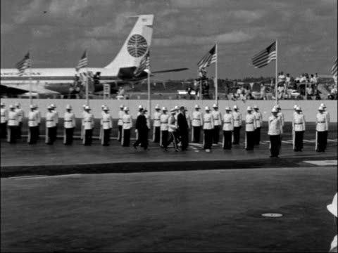 us president john f kennedy arrives in nassau for talks with harold macmillan bahamas nassau president kennedy from plane greeted by governor and... - john f. kennedy us president stock videos and b-roll footage