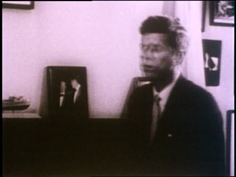 us president john f kennedy displays and discusses his model of the pt109 ship - john f. kennedy us president stock videos and b-roll footage