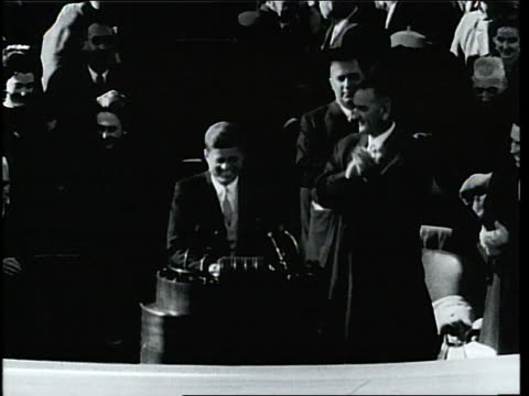 president john f kennedy gives a speech in front of a large audience after supreme court justice earl warren swears him in at the white house - john f. kennedy us president stock videos & royalty-free footage