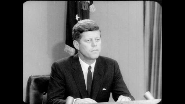 / president john f kennedy giving a speech after the continued segregation of african american students from the university of alabama / he concludes... - john f. kennedy politik stock-videos und b-roll-filmmaterial