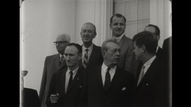 president john f kennedy meets with congressional leadership senator sam rayburn hubert humphrey john mccormick and other men and shakes hands on the... - sam rayburn video stock e b–roll