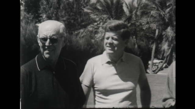 stockvideo's en b-roll-footage met president john f kennedy peter lawford joe kennedy on golf course / president kennedy exits plane shakes hands with officers jacqueline kennedy... - jacqueline kennedy