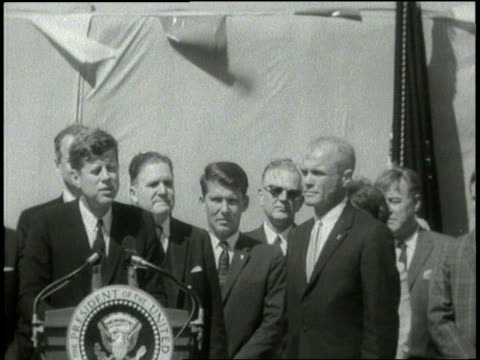 us president john f kennedy presents nasa's distinguished service medal to astronaut john glenn - 1962 stock-videos und b-roll-filmmaterial