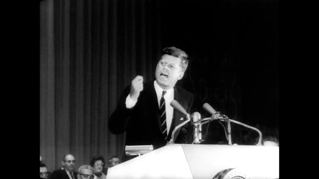 / president john f kennedy receives stand up ovation when he goes up to speak at uaw conference / walter reuther stands beside the president at the... - john f. kennedy politik stock-videos und b-roll-filmmaterial