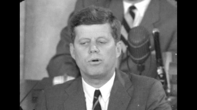 """president john f. kennedy says """"i believe that this nation should commit itself to achieving the goal before this decade is out of landing a man on... - 1961 stock videos & royalty-free footage"""
