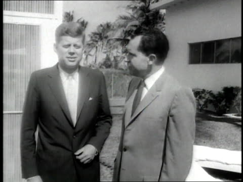 us president john f kennedy shakes hands with defeated us presidential candidate richard nixon after the election - john f. kennedy us president stock videos & royalty-free footage