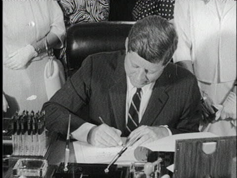 president john f. kennedy signs the equal pay act. - john f. kennedy us president stock videos & royalty-free footage