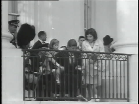 u.s. president john f. kennedy sits with his wife and children on a white house balcony in the last family picture before his assassination. - john f. kennedy us president stock videos & royalty-free footage
