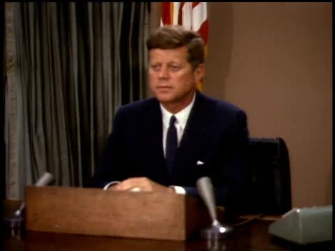 vidéos et rushes de president john f kennedy sitting behind podium / washington dc united states - 1963